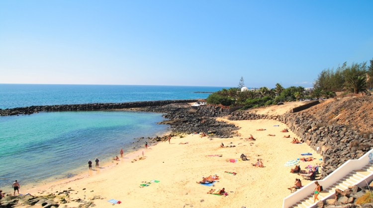 Tourists on a beach in the Canary Islands